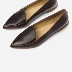 "Make your point in these refined flats 100% full-grain Italian leather Smooth leather on the body of the shoe is complemented by textured leather on the upper inset Crescent-shaped tongue lends a feminine touch ¾"" stacked leather heel, with contrast rubber for durability"