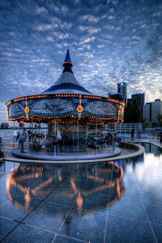 Carousel on Detroit Riverwalk, Located in the Philip A. Hart Plaza in downtown Detroit, is a city plaza along the Detroit River, along with other Memorials and sculptures Carrousel, Detroit Area, Detroit Michigan, Detroit Riverwalk, Illustration Photo, Ville New York, Carnival Rides, Merry Go Round, Carousel Horses