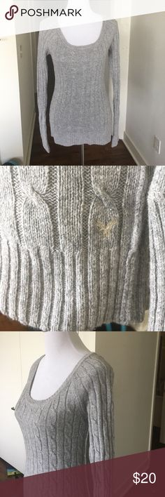 American Eagle Outfitters Wool Blend Cable Sweater EUC! This sweater is authentic AEO and is in excellent condition! Light gray wool blend with a scoop neck. Silver Eagle emblem. No holes, rips, or stains!🚫Please do not leave advertisements for your closet only listings! No trades!🚫 American Eagle Outfitters Sweaters Crew & Scoop Necks