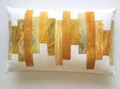 "Cushion ""rhythm"" in yellow and copper shades."