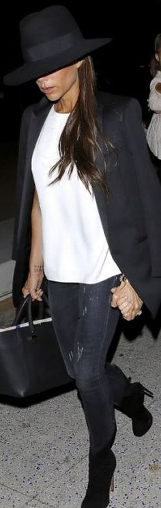 Victoria Beckham: Hat – Maison Michel  Purse – Victoria Beckham Collection  Jeans – R13