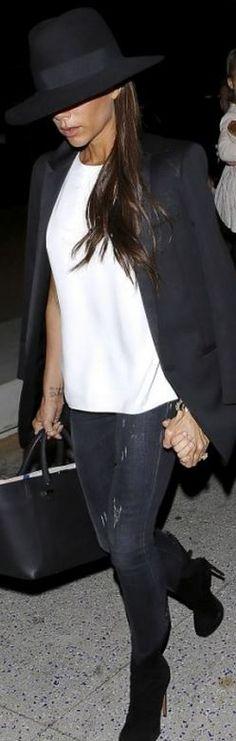 Victoria Beckham: Hat – Maison Michel  Purse – Victoria Beckham Collection  Jeans – R13