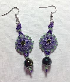 I am in love with this pattern and had to make another pair today .. Beaded Victorian Earrings made with super duo beads .. Swarovski bicones .. montees and seed beads .. large glass bead hangs from bottom .. Designed by Jann Tague .. Clever Designs .. https://www.facebook.com/#!/JewelsByJann