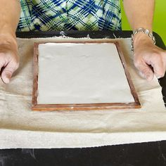 Step Five Mix plaster of Paris according to instructions, and pour a thin layer into the frame on top of the clay.
