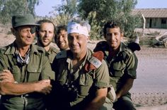 Israeli Defense Minister Moshe Dayan (l) and general Ariel Sharon (m) at the bridgehead crossing of the Suez Canal in October 1973
