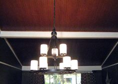 Easy-to-install, tongue-and-groove planks add architectural interest to a vaulted ceiling.