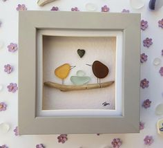 Fantastic and original pebble and sea glass art picture of two sea glass love birds standing on a driftwood branch looking at their nest and egg made out of sea glass. This sea glass art comes in a cute little shadow box frame. This is a pebble picture of an adorable sea glass bunny with
