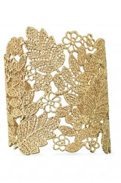 "Gold plated filigree cuff was inspired by a piece of vintage lace.  A beautiful statement piece.  As seen in Fitness Magazine.    3"" length.  2 1/4"" inner diameter.  Fits S-M wrists.  Lead & nickel free.  Hypo-allergenic."