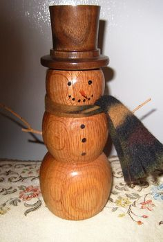 Hand Turned Oak Wooden Snow Man.  via Etsy.