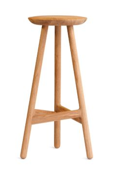 Ninety stool, simple and pure with clever design and detailing, particularly around the footrest.  Providing ergonomic foot support.  Example of practical and beautiful design.  Pictured here in Oak.