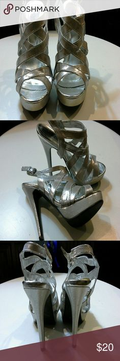 HOLIDAY SALE * NEW * Gorgeous Silver high heels Never worn.  In excellent condition Charlotte Russe Shoes Heels