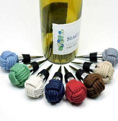 Nautical Knot Bottle Stoppers: http://www.completely-coastal.com/2016/05/coastal-nautical-kitchen-gadgets.html Handmade in USA by Mystic Knotwork.