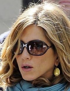 THESE GLASSES.  Also love the earrings, and lipstick.  Jennifer Aniston