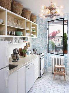 Love this small galley kitchen...great wallpaper, open shelves, subway tile flooring and tiny gas stove :)