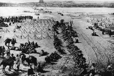 Feb. 1, 1904: hundreds of Japanese infantrymen wait to enter Pyongyang, Korea.