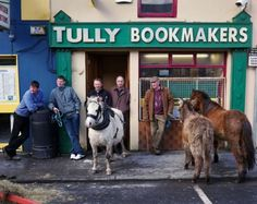 Outside a bookmakers in Ireland!     Meanwhile the boys rode to town to place their bets on the Euro's survival!