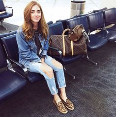 Chiara Ferragni of The Blonde Salad in a denim jacket, distressed jeans, and leopard print slip-ons
