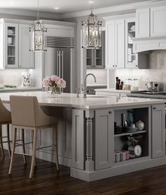 Stunning shaker cabinets painted an airy light gray.