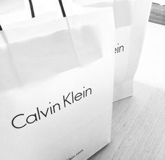 Ck's packaging or bag image whenever a customer purchases an item from the brand following it's theme which is minimalistic.