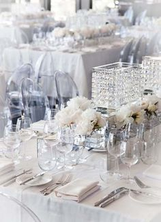white and silver table setting, so elegant, yet so modern.
