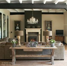 like the dark paint around the light colored fireplace (and the table behind the couch)