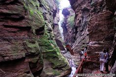"""Longtan Valley (河南龙潭大峡谷) This U-shaped valley marked by a stripe of purplish red quartz sandstone has earned the name, """"The Valley of Narrow Gorges in China."""" Its steep cliffs, lush vegetation and jagged valley attract sightseers from all over China. Beautiful Places To Visit, Oh The Places You'll Go, Cool Places To Visit, Amazing Places, China Vacation, Visit China, Famous Places, China Travel, Where To Go"""