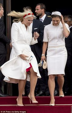 Watch out for the wind! Norway's Crown Princess Mette-Marit, 41, and Sweden's Crown Princess Victoria