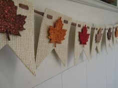 Fall - Leaves - Thanksgiving - Burlap Banner. Easy to make. Flags from burlap, woven ribbon to anchor flags and form bunting, attach leaf punch paper topped with glitter??