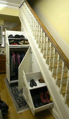 This is just how I would like our Under stairs storage to be!! The spindles on the stair case are great too!! Dee