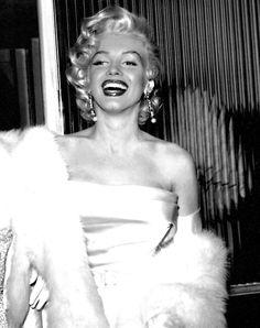 Marilyn Monroe shines in white satin