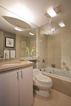 baño con azulejos color beige