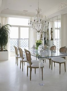 "Lighting Rules: distance between the bottom of the chandelier and the top of the table should be 30"" - 34"" in a room w/ an 8' ceiling. Add 3 inches for each additional foot of ceiling height. Chandelier diameter should be equal to one-half the width of the table as a general rule. But a light and airy piece may be slightly larger."