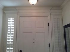 Crown Molding Valances over our front door and sidelights.  The right-hand sidelight shutter is over a blank wall (no actual window behind it) for symmetry.