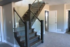 10mm clear tempered glass stair railings with Brushed Nickel clamps.  grandriverglass.com