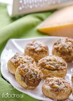 Stuffed Parmesan Mushrooms Recipe -- Stuffed mushroom caps with mushrooms, parsley and 2 kinds of cheese. Light, filling and full of flavour party appetizer.