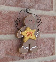 Wood Gingerbread Man Ornament with a star for Christmas tree, Noel, wall hanger, home decor. $6.50, via Etsy.