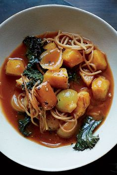 This winter squash soup recipe incorporates onion, kuri squash, crushed tomatoes, ginger, cloves, angel hair pasta and kale to create the ultimate comfort food meets fall recipe. Whether you're looking to make this squash recipe for a cozy fall dinner or pack it for lunch the next day, it's a great choice for a pasta recipe.#fallrecipes #comfortfood #souprecipes #squashrecipes #squashsoup #pastarecipes #noodlesoup