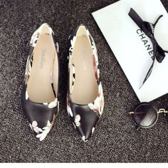Floral Pointy Flats China size 35 = US size 5.5  Material & Care Information Material:	Shell: Polyurethane , Lining : Polyurethane Color:	Black Wash care:	Wipe Clean Shoes Flats & Loafers