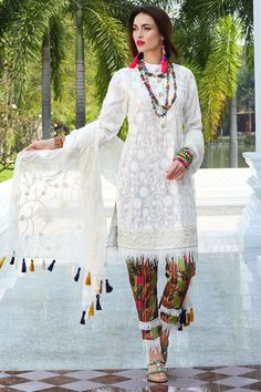 0b229b0f00c This pearl white extremely beautiful three piece unstitched dress by Motifz  casual collection 2018 wintercollection