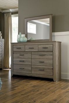 Sofisticación #urbana con un aire decididamente relajado es nuestra cómoda con espejo #Zelen.   <3 Ven y conoce #ContemporaryLiving <3  #AshleyFurnitureHomeStore #estilo #muebles #accesorios #diseño #Cama   ---  B248-31 Dresser B248-36 Bedroom Mirror