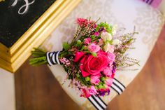 Fun and flashy pink bridal bouquet, stripes Floral design by Kari Shelton | Pink Parasol Designs | The Frosted Petticoat http://www.theflowergirltx.com/