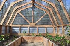 In this article, we are going to have a look at what greenhouses are and how you can construct a simple, homemade DIY greenhouse for your garden or farm. Building A Barn Door, Diy Barn Door, Diy Door, Backyard Greenhouse, Greenhouse Plans, Cheap Greenhouse, Window Greenhouse, Homemade Greenhouse, Greenhouse Growing