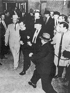 On November 24, 1963, Jack Ruby shoots and mortally wounds Lee Harvey Oswald, the accused assassin of President Kennedy.