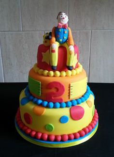 Three Tier Mr Tumble Themed Cake http://www.dawnscustomcakeshop.co.uk/Childrens-Tiered-Cakes.html