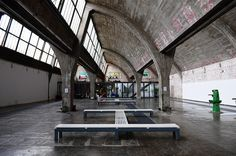 798 Art Zone (Beijing) - Space gallery  Old Maoist slogans are still visible on the ceiling arches.
