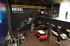 Car Showroom, workshop and offices for BMW/ Mini Located in a Motor Industrial Area close to Madrid.The building consist in a double story buildind, divided ...