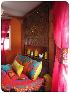 not sure if my husband would sleep in this bed but I love the colors-bohemian bedroom