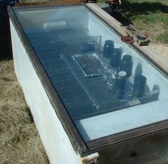 This solar oven was made from a patio door and an old freezer. Since then I've removed the shelves. The device has no reflectors and still gets hot enough to cook brisket. Survival Prepping, Survival Skills, Emergency Preparedness, Solar Stove, Solar Cooker, Pool Heater, Led Lantern, Rocket Stoves, Diy Solar