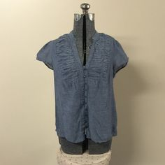 Blue Gray Buttondown Top Very nice blue gray/slate colored buttondown short sleeve top. This may look like a denim type of shirt but it is not; is it extremely soft and very light, airy feeling. Please ask if you have any questions, need any measurements or more pictures.                                                    ✨Feel free to make an offer!✨ ✨No trades!✨ ✨Discounts on bundles!✨ Tops
