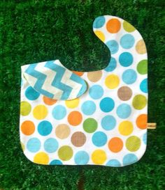 Oversized No Mess Reversible Bib in Summer Skies/ Chevron Aqua. Wear it on your tot during feeding time. The oversized bib protects your child's clothing... No need to worry about spills, stains and mess! Best especially for moms who are scared of getting their child's clothes dirty! =)  Send us a message at info@ilovebabinski.com & LIKE us on Facebook  Php 120.00 www.ilovebabinski.com